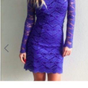 Alexis blue lace cocktail dress.